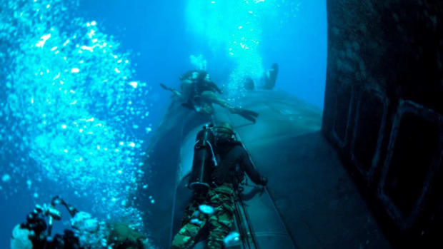 U.S. Navy SEALS train on the USS New Mexico (SSN 779)