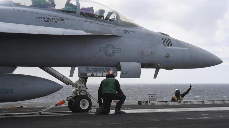 Showdown: What Happens When a Battleship Fights an Aircraft Carrier?