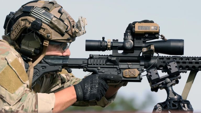 Computer-Controlled Precision Sniper Rifles Hit Moving Targets 500 Yards Away