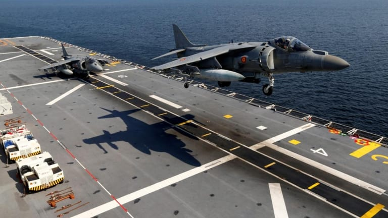 Why Did the U.S. Navy Choose Super Aircraft Carriers Over Medium Carriers?