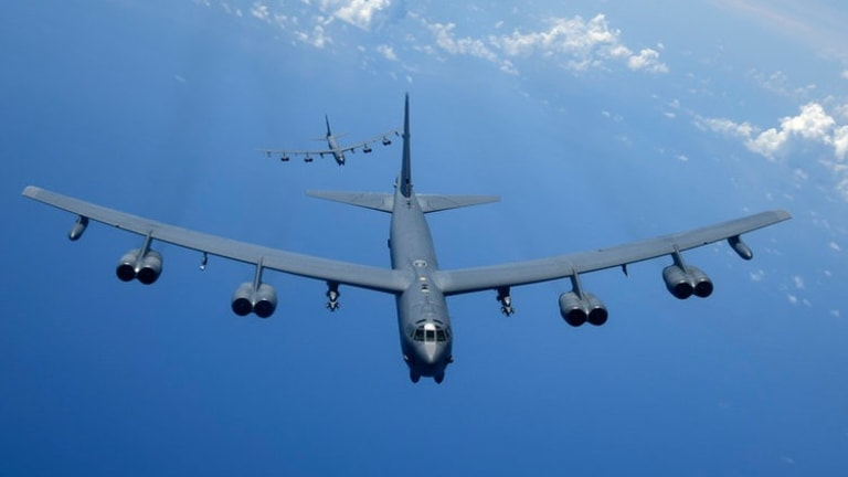 A B-52 bomber shows it can drop mines at sea from nearly 50 miles