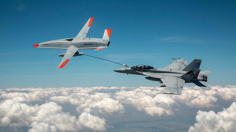 Historic Breakthrough: Drone Refuels F-18 in Flight