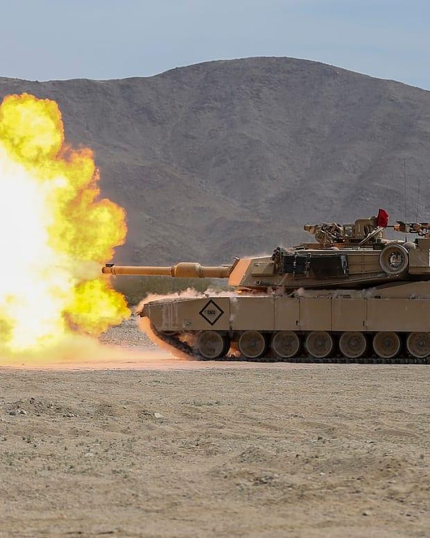 1600px-M1A1_firing_(48910313236)