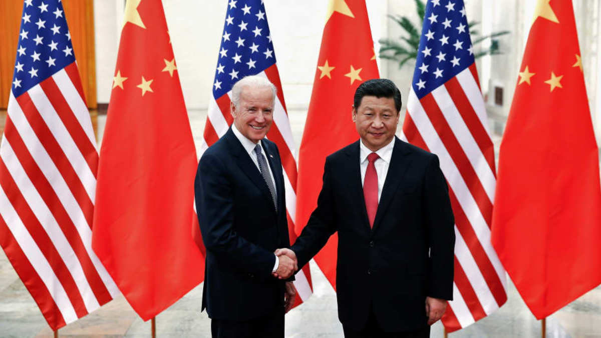 Chinese President Xi Jinping shakes hands with U.S. Vice President Joe Biden (L) inside the Great Hall of the People in Beijing December 4, 2013.