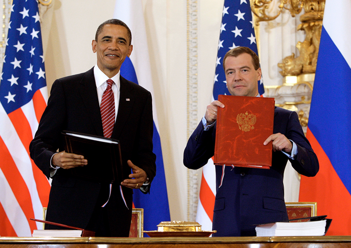 U.S. President Barack Obama and Russian President Dmitry Medvedev hold documents after signing New START on April 8, 2010. If the treaty expires in one year, the United States would lose its ability to conduct on-the-ground verification in Russia and would have reduced confidence its assessment of Russian nuclear forces. (Photo: Dmitry Astakhov/AFP/Getty Images)